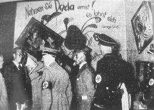 Adolf Hitler and Adolf Ziegler visit the Degenerate Art exhibition, 1937.